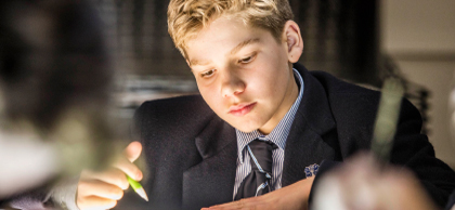 Melbourne Grammar School boy in class