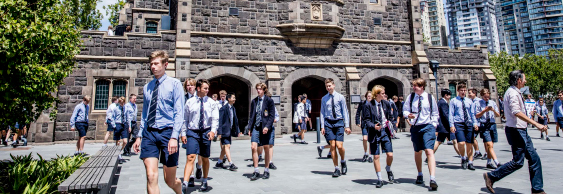 Melbourne Grammar School boys outside bluestone building