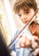 Melbourne Grammar School boy playing violin