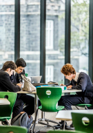 Melbourne Grammar School boys studying in library