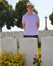 Year 9, stands behind the gravestone of Dr Maldwyn Leslie Williams (OM 1903)